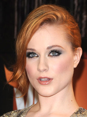 Swoopy layers in front create a delicate symmetry for Evan Rachel Wood's side-swept chignon.