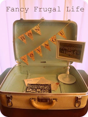 http://fancyfrugallife.com/vintage-suitcase-honeymoon-fund-wedding-decor-2/