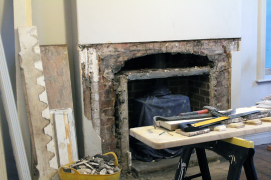 ripping out a fireplace