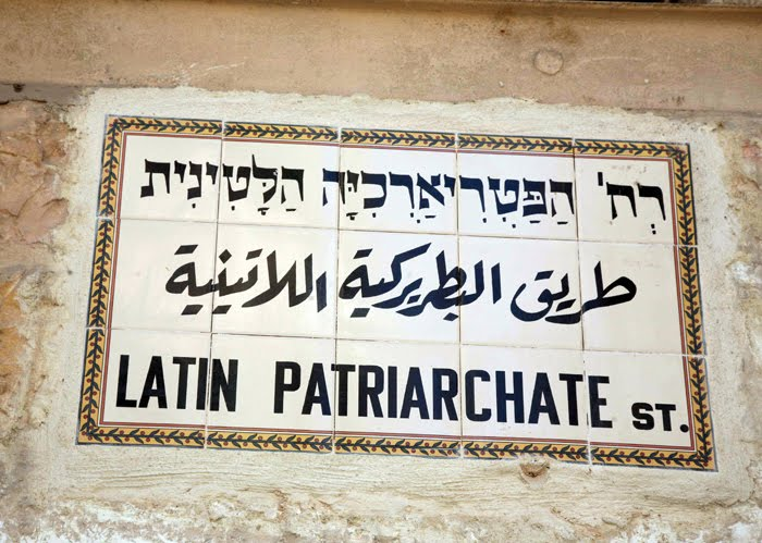 ... of the Old City of Jerusalem - sign in Hebrew, Arabic, and English.