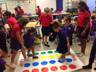Aleigha and Sophia playing Twister for Dot Day