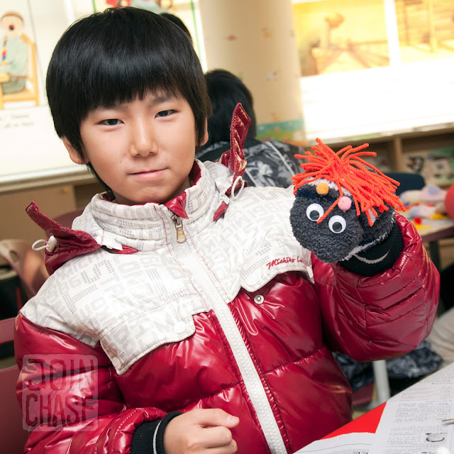 A student making a sock puppet during Winter English Camp at Bibong Elementary in Ochang, South Korea.