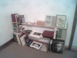 The first bookcase, made from the six odd-sized members, illustrates the idea of giving objects plenty of space within the shelves.