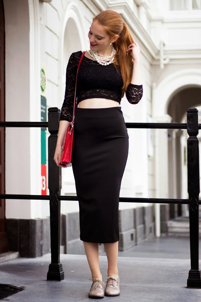 Vintage fashion blogger outfit with a lace crop top and midi pencil skirt