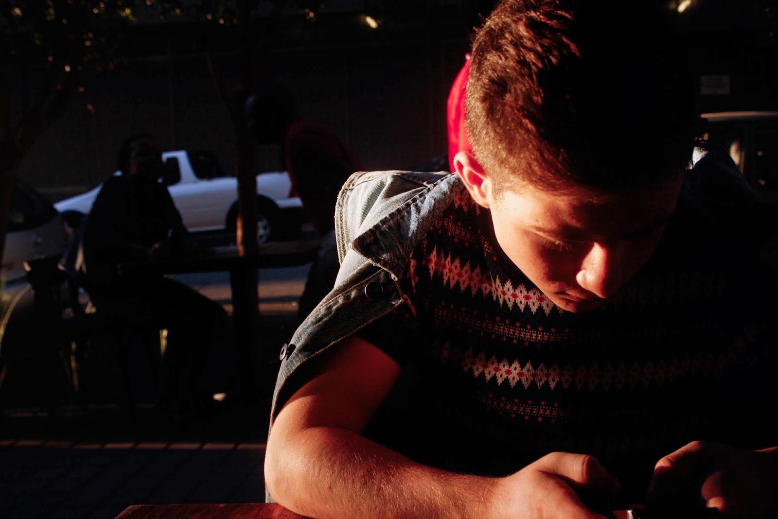 josh on his phone at pata pata maboneng precinct