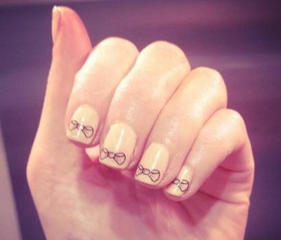 notd peach nails with bows i heart cosmetics