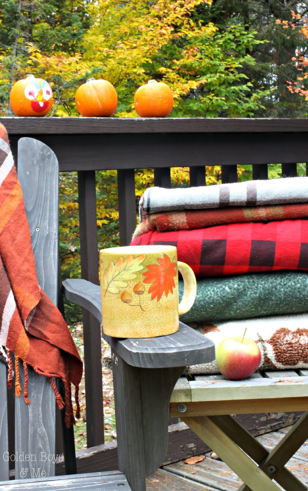 Stacked plaid blankets with fall decor-www.goldenboysandme.com