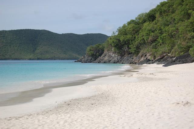Gentle waves on the powdery sand beach at Cinnamon Bay St John US Virgin Islands