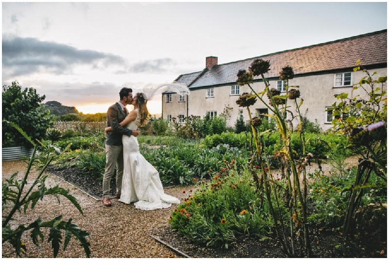 Bride and groom in the sunset at River Cottage HQ in Devon