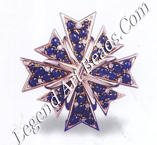 A sapphire and diamond Maltese cross brooch, designed 1950.