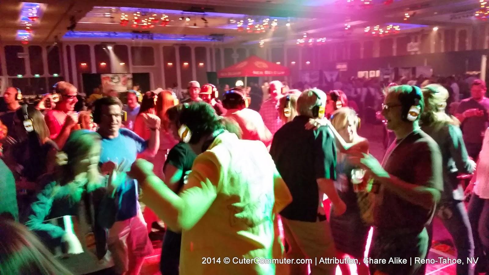 People dancing to music through headphones on the silent disco floor.