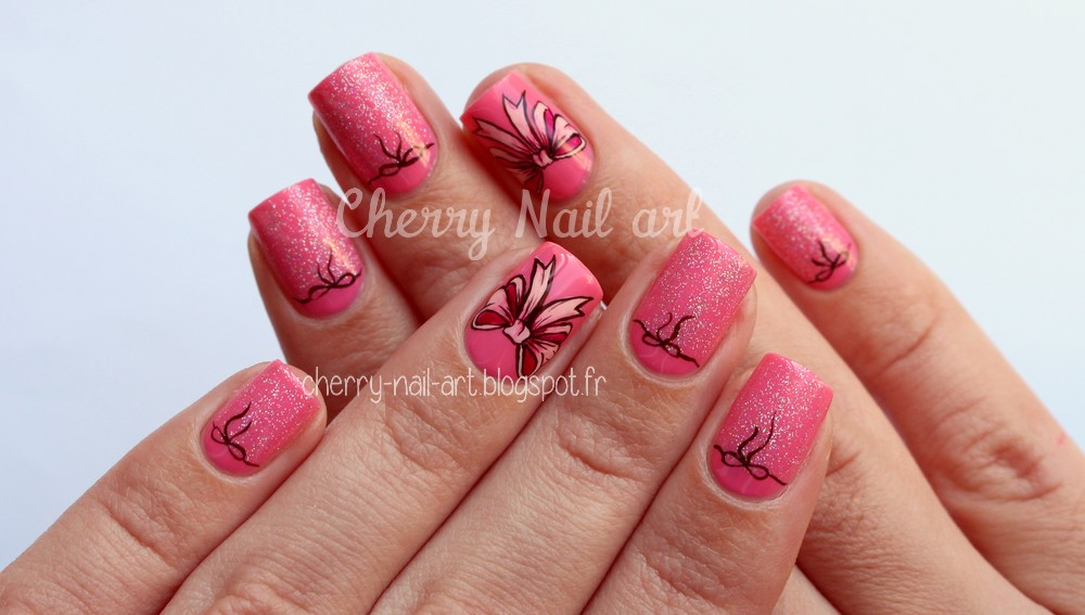 nail art noeud rose paillettes