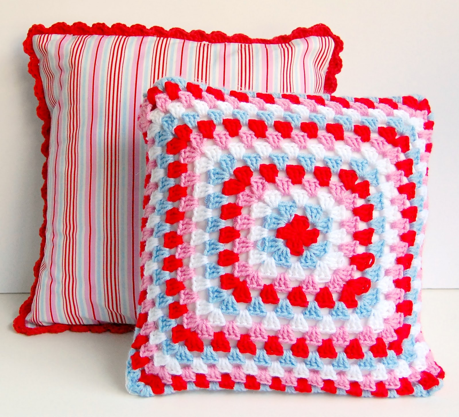 hopscotch lane pink red and blue pillows
