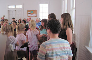 Laurel reads to children at Rehobeth United Methodist Church