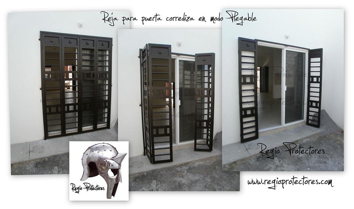 Regio protectores reja para puerta corrediza en modo plegable for Puertas metalicas para patio