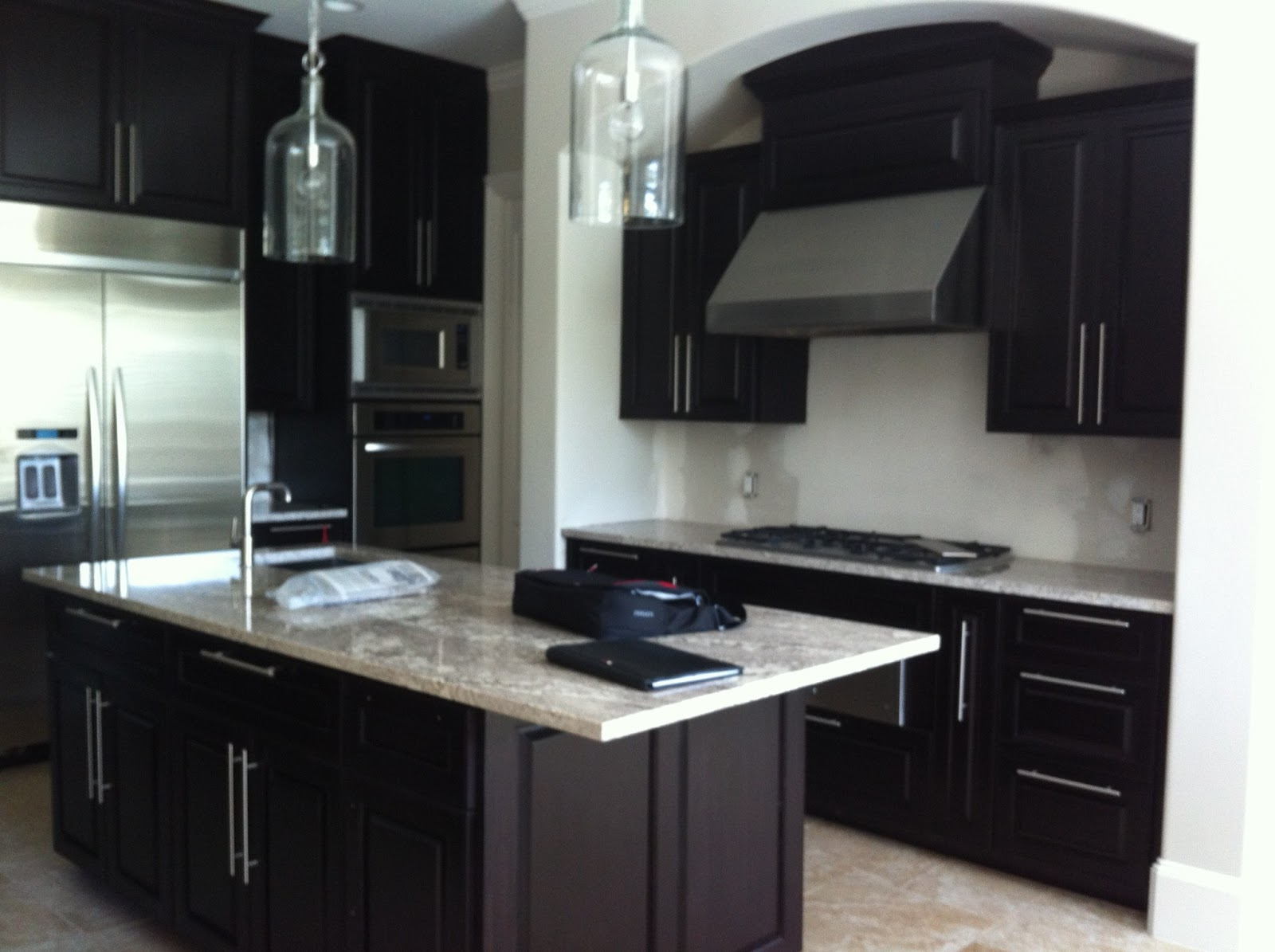 Fireplace tile archives spaces designed interior design for Black kitchen cabinets with dark floors