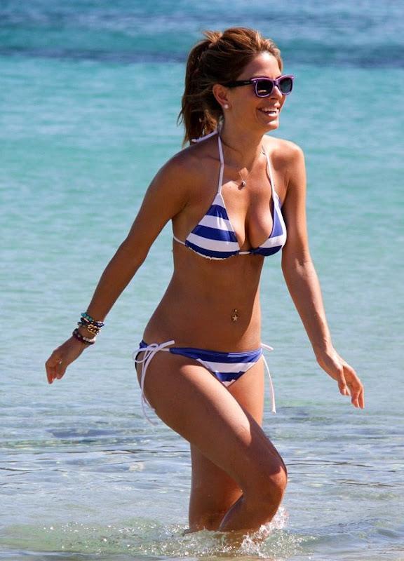 Maria Menounos wearing a blue an dwhite striped bikini in Greece