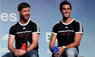 Xabi Alonso and Arbeloa with the new Adidas boots