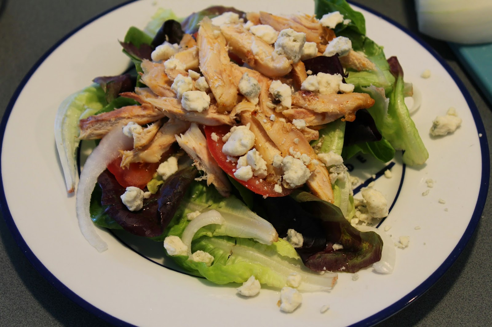 buffalo wing salad, blue cheese, onions, tomatoes, salad greens mix