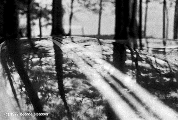 """long surfboard on a table"" (c) 1977 george elasser"