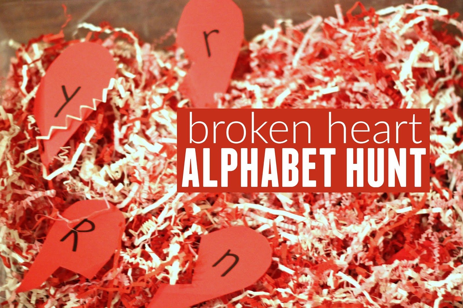 Toddler approved broken heart alphabet hunt crinkled shredded paper is one of our favorite sensory materials to play with so i used it to make a simple broken heart alphabet hunt spiritdancerdesigns Images
