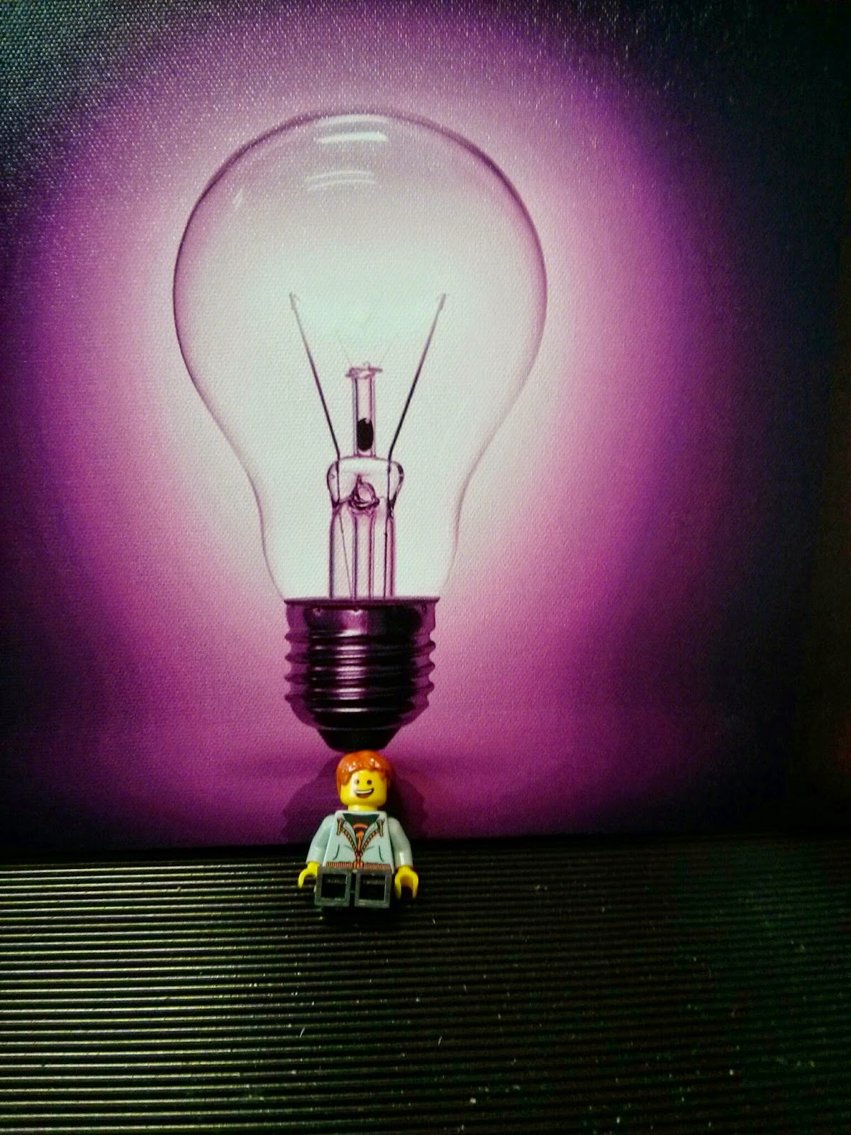 Kyle Emmett in front of a light bulb picture