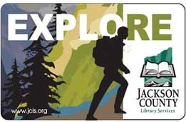 "Jackson County Library Services' library card. Caption ""EXPLORE"" above silhouette of hiker with a wooded mountain background"