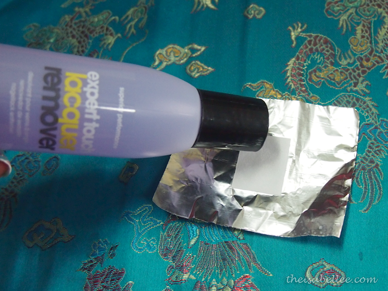 Pour OPI Expert Touch Lacquer Remover on cotton