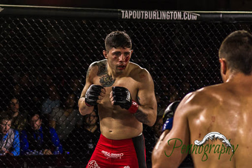 Global Warrior F.C. 2, Adam Assenza vs Taylor Solomon at Burlington Central Arena in Burlington, Ontario on May 30, 2015. Photo: Jeremy Penn / Pennography  NIKON D7100 AF Zoom 17-55mm f/2.8G 1/500, f/2.8 ISO: 1600