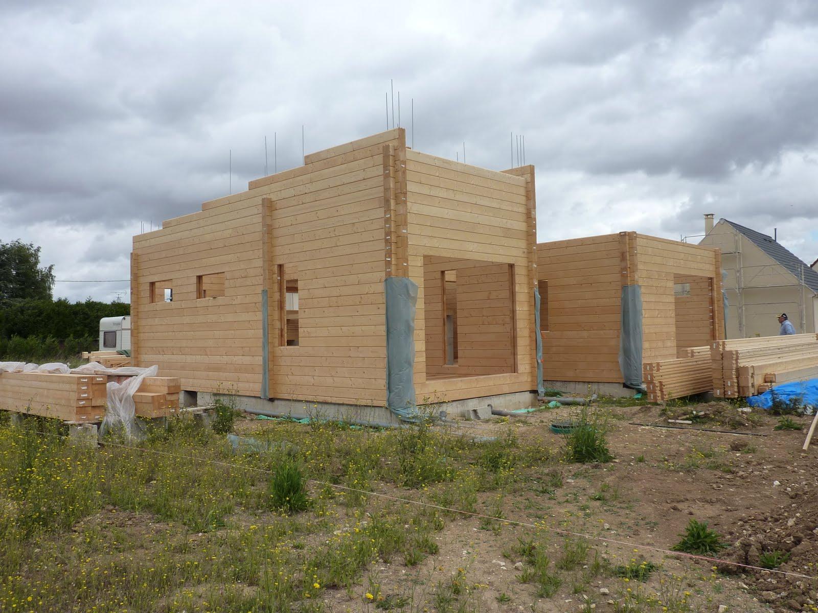 Chantier maison madier bois architecte maison bois for Chantier architecte