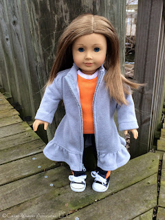 Bree visits Lansing with orange jeans-outfit by Geiser-Weaver Associates