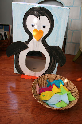 homemade penguin toss box with bean bag fish