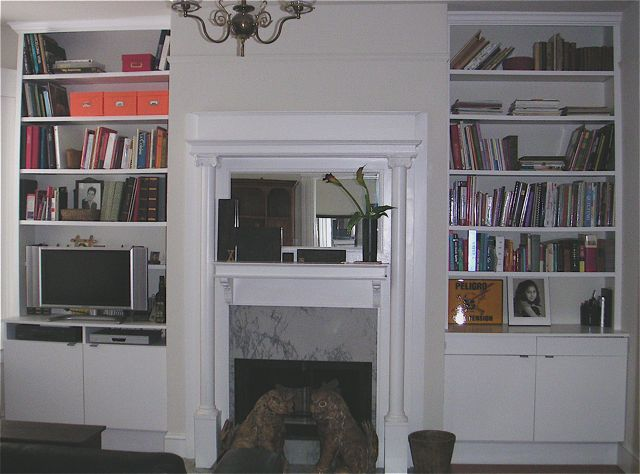 Creative  Bookcaseoneithersideofthefireplacewithacrispmatchingmantle