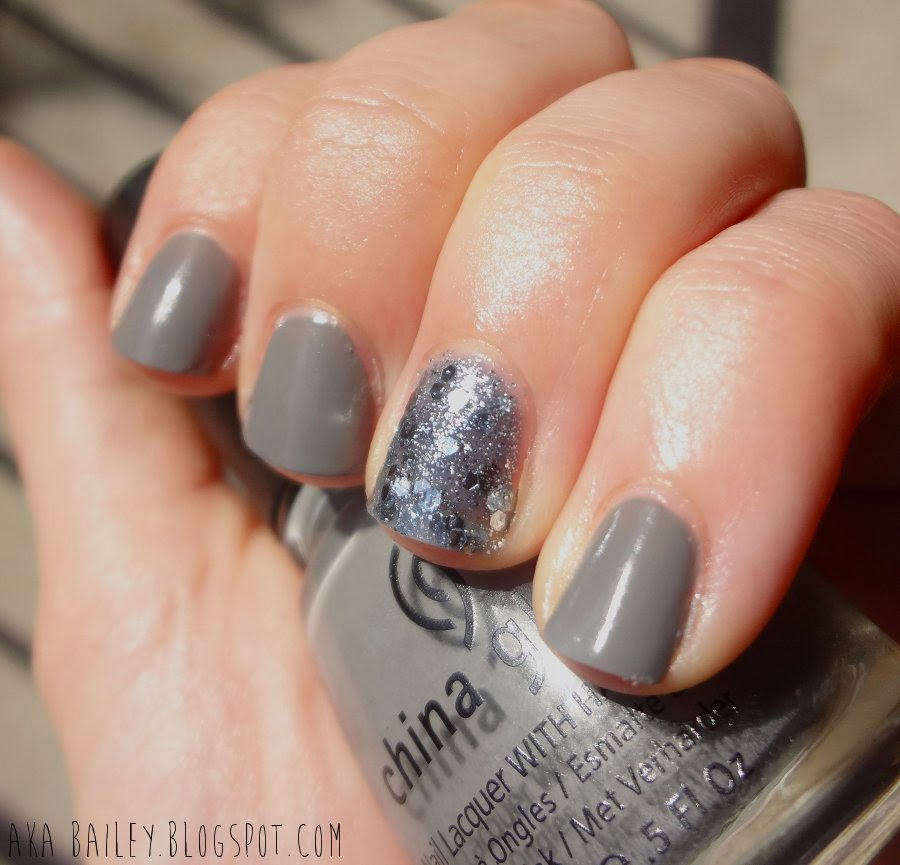 Grey nails with a blue silver sparkle glitter accent nail, China Glaze Recycle