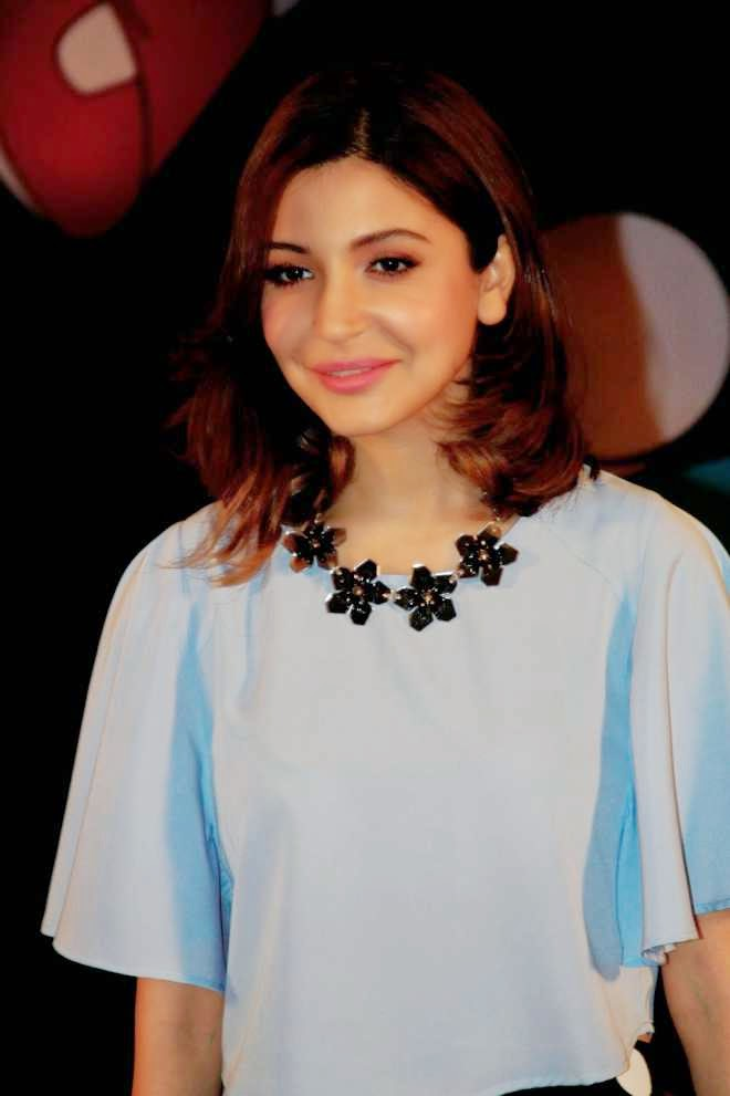 Anushka Sharma Latest Stills in Sky Blue Top and Black Mini Skirt