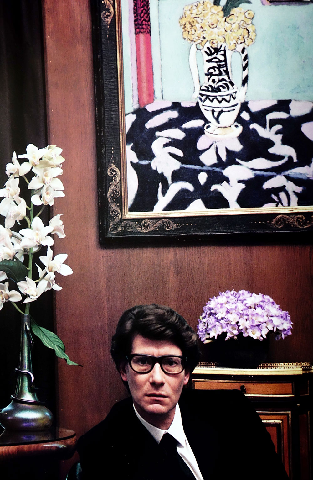 Yves Saint Laurent at his apartment on the rue Babylon photographed by Duane Michel