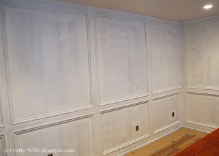 First coat of BIN primer on wood judges paneling walls