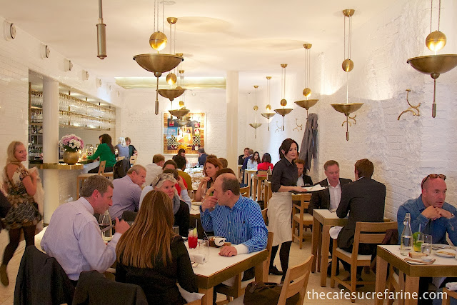 Photo of the dining area in Nopi Restaurant in London, England.