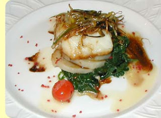 Chilean Sea Bass with hazelnut Rolled Asparagus