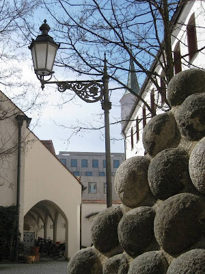 Wrought iron lamp and stack of cannonballs