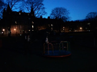 Roundabout in darkness, Meadows Park West, Edinburgh
