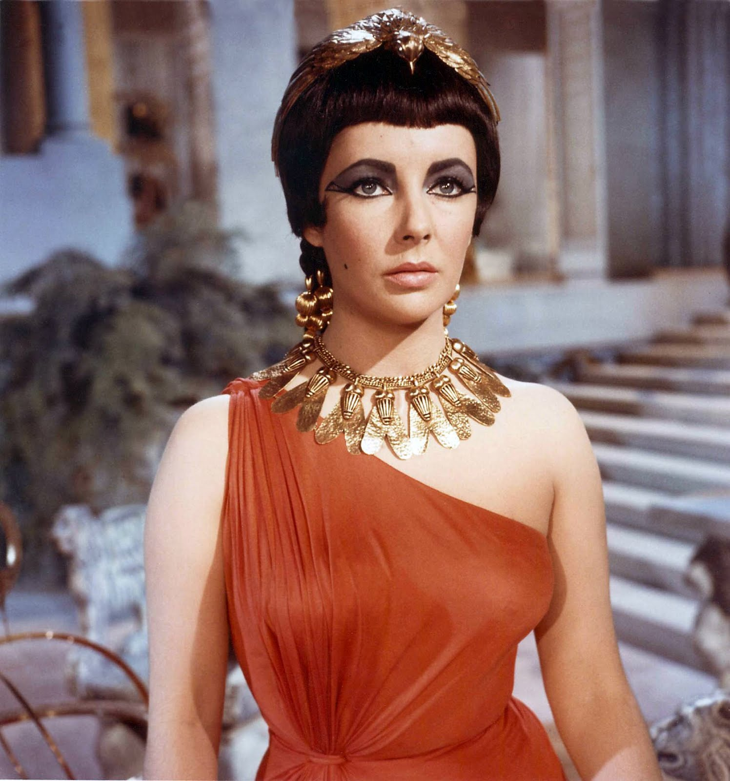 D Queen Elizabeth Taylor As Cleopatra In Rust Colored Jersey And Blue Key Hole Neckline Dresses Designed By Costume Designer Irene Sharaff