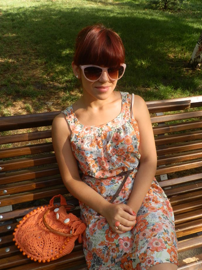 Outfit I am wearing: Lightweight orange floral summer dress handmade by my mom; orange knitted purse handmade by my mom, orange Zara wedges, thin brown belt, cat eye pink sunglasses and rings with oranfe stones from H&M, pearl earrings