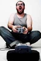 Excited adult male video gamer