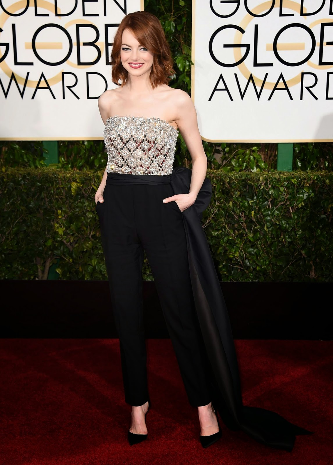 Emma Stone sizzles in a jumpsuit at the 2015 Golden Globe Awards