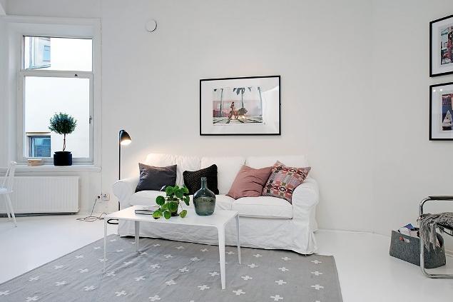 Salón en blanco, rosa y gris