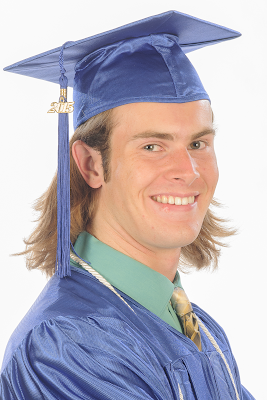 photo of Austin in cap and gown.