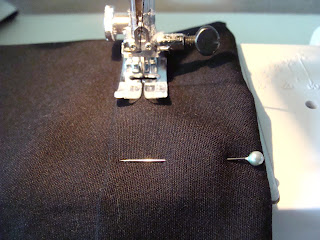 Hem pants by folding under seam and straight stitching