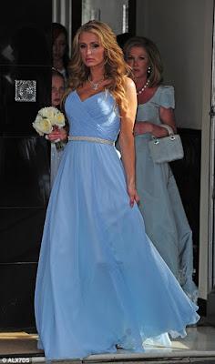 Bridesmaid Paris Hilton wore a periwinkle blue gown