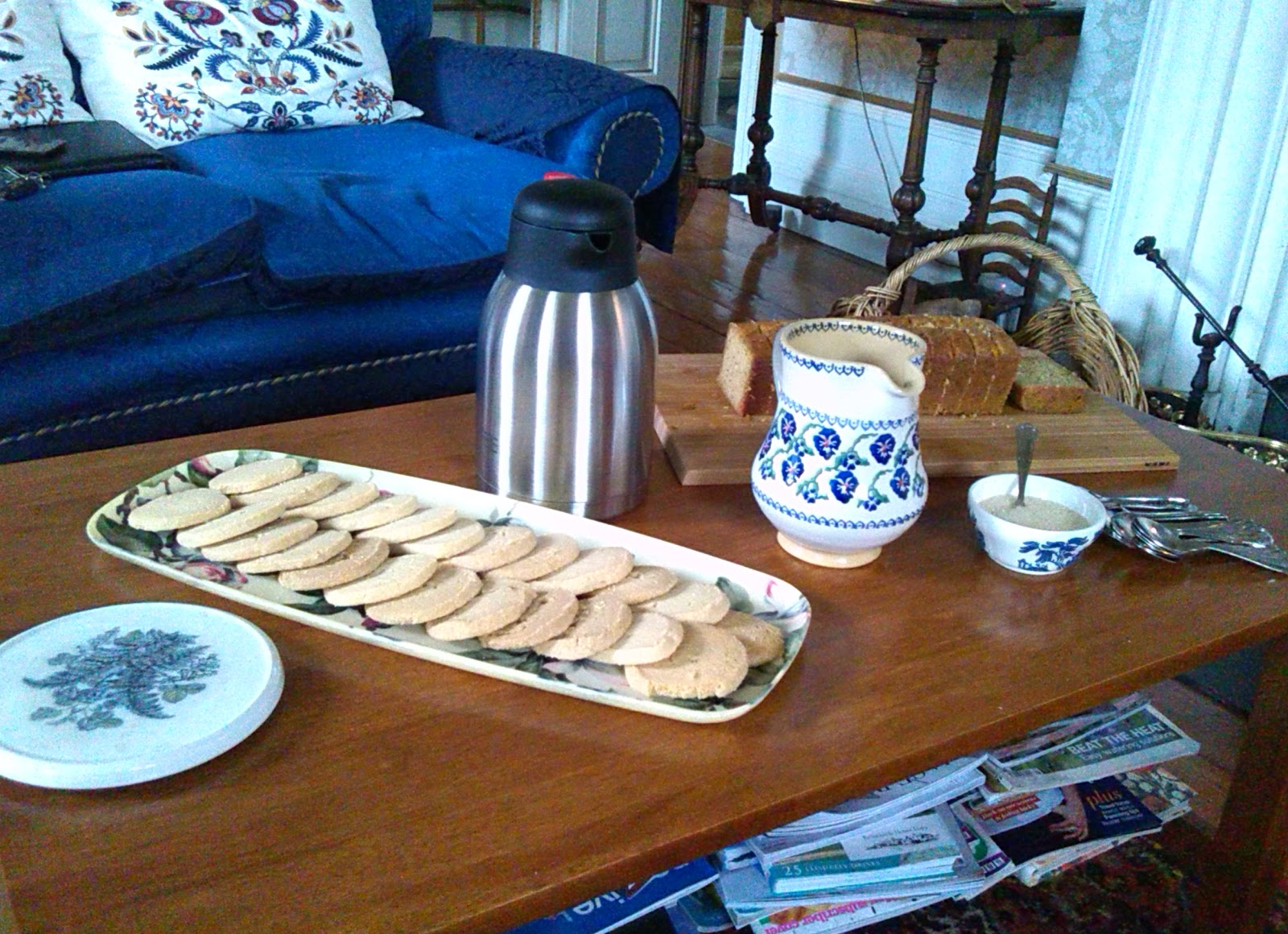 Homemade shortbread biscuits and homemade cake. Tea & coffee